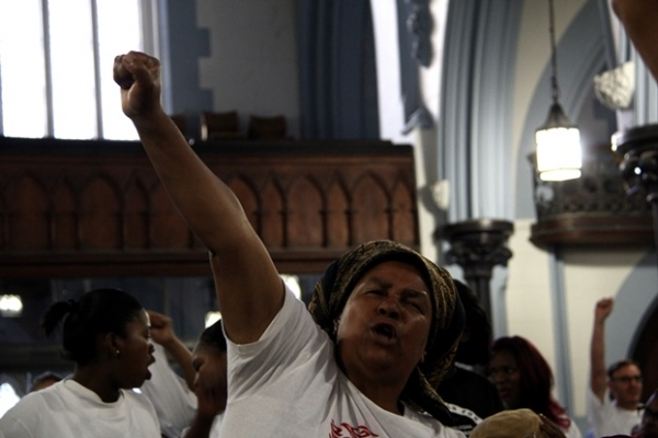Juliet Plaatjies, a Social Justice Coalition member from Khayelitsha, joins in singing struggle songs at the Right2Know campaign's mass meeting in the CBD. Picture by Daneel Knoetze.