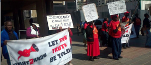 R2K members picketing outside the Arms Deal Commission.