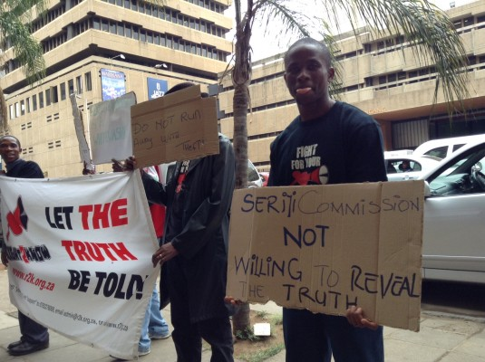 Right2Know protesters outside the Department of Justice and Constitutional Development in Pretoria call for the Seriti Commission to be scrapped. Picture: Amanda Watson